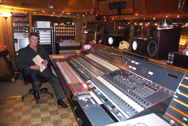 Bruce Stratton sitting at console in recording studio